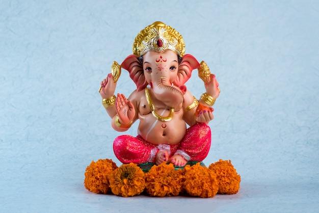 Hindu god ganesha. ganesha idol on blue.