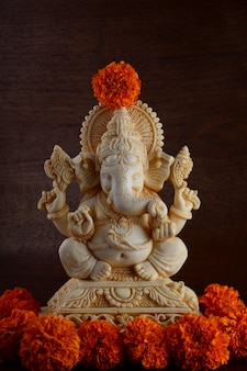 Hindu god ganesha. ganesha idol on brown background