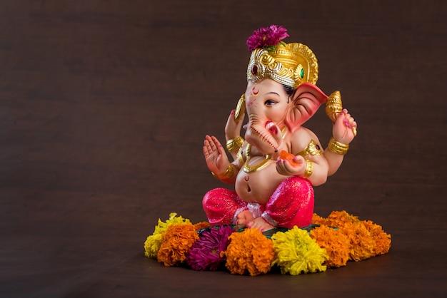 Hindu god ganesha. ganesha idol on dark.