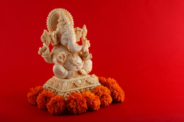 Hindu god ganesha. ganesha idol on red space