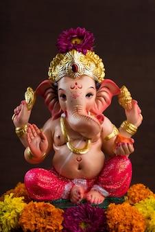 Hindu god ganesha. ganesha idol on red