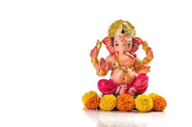 Hindu god ganesha. ganesha idol on white.