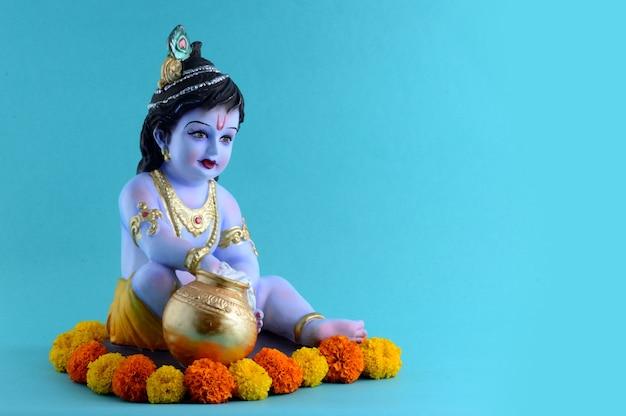 Hindu god krishna on blue surface