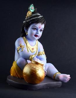 Hindu god krishna on dark surface