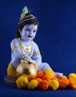 Индуистского бога кришны на синей поверхности