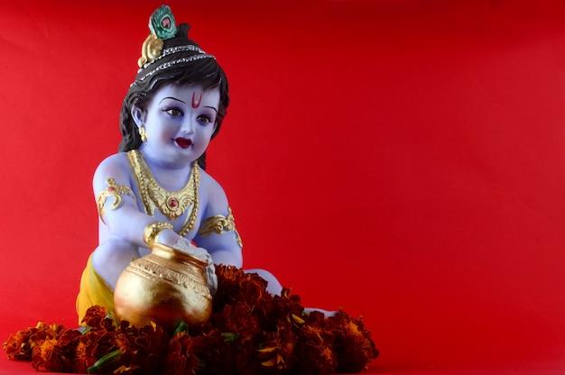 Hindu god krishna on red surface