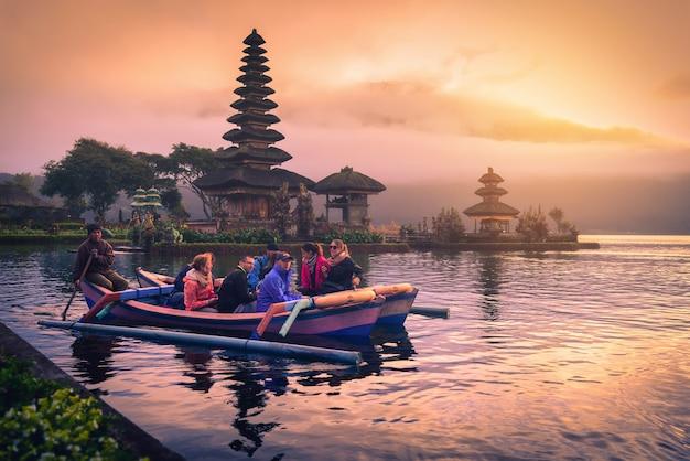 Hindu temple on bratan lake landscape at sunrise in bali, indonesia