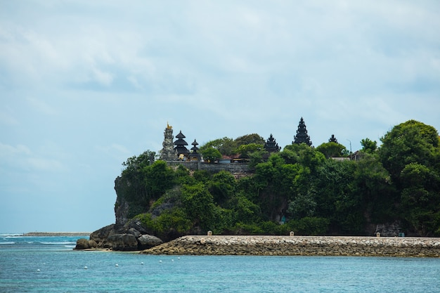 Hindu temple on the cliff of a mountain on the seashore in the middle of the jungle