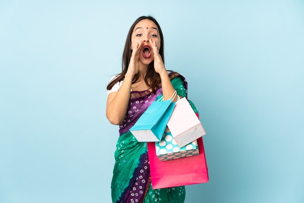 Hindu woman with shopping bags