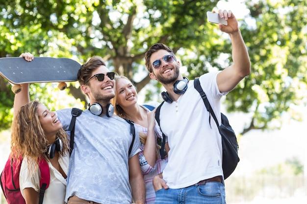Hip friends taking selfie outdoors