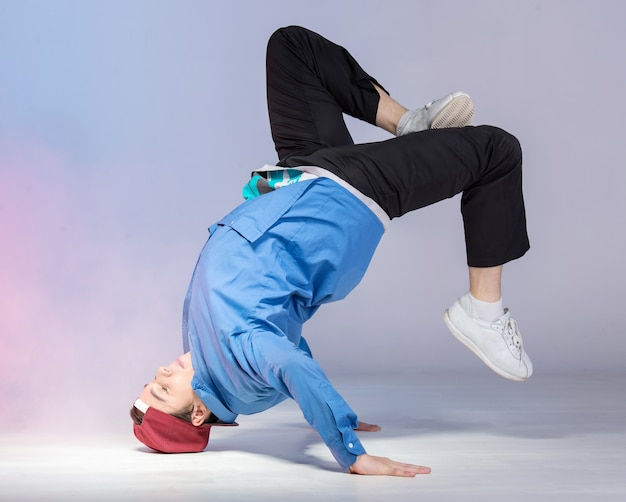 Hip hop dancer is showing some movements.