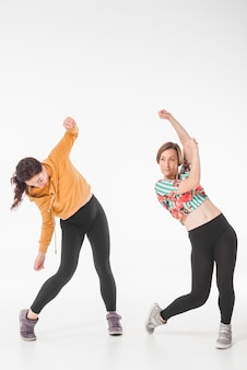 Hip hop female dancers dancing over white background