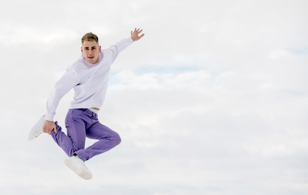 Hip hop performer posing mid-air