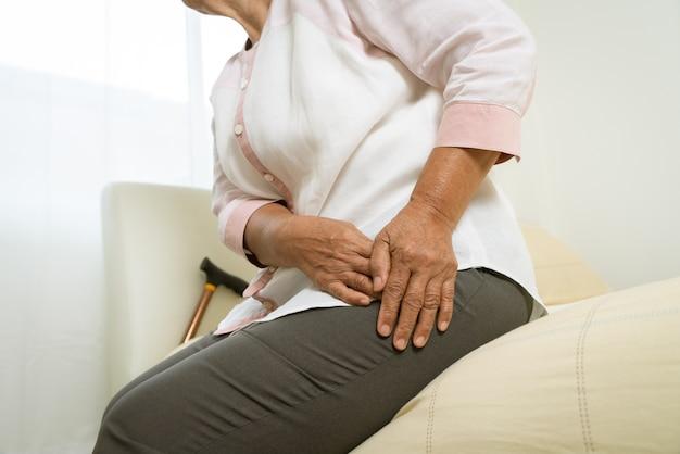 Hip pain of senior woman at home