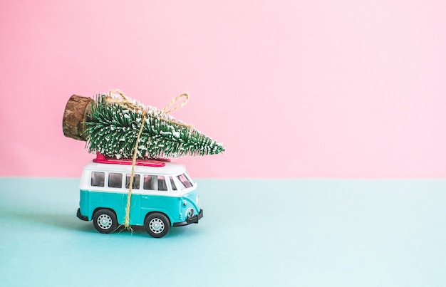 Hippie bus with new year christmas fir tree on the roof miniature small car banner party theme