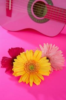 Hippie flower yellow pink gerbera on guitar