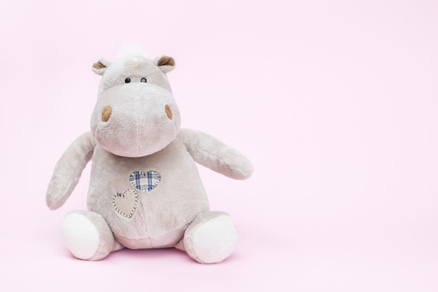 Hippo toy on a pink background