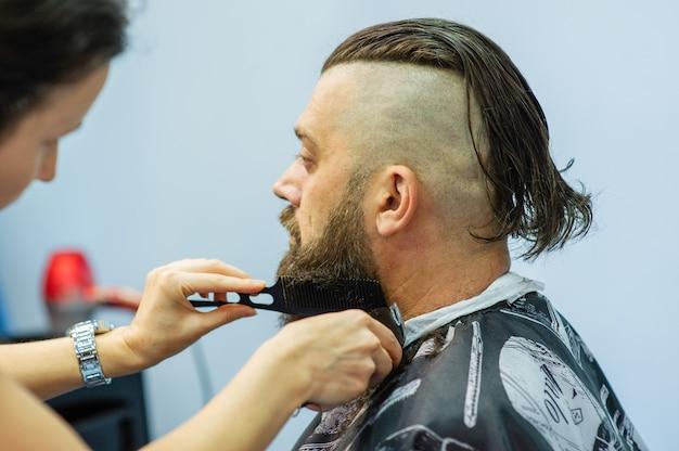 Hipster client visiting barber shop. mens fashion. bearded man after barber shop. man hipster