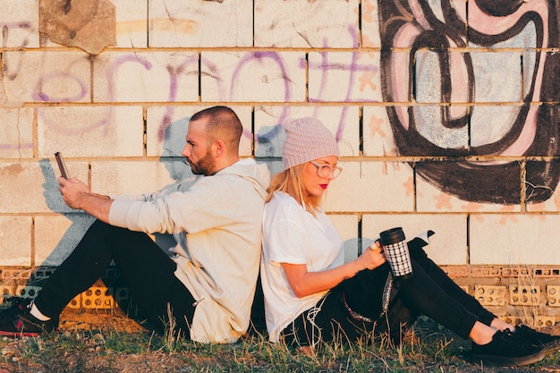 Hipster couple relaxing outside Free Photo