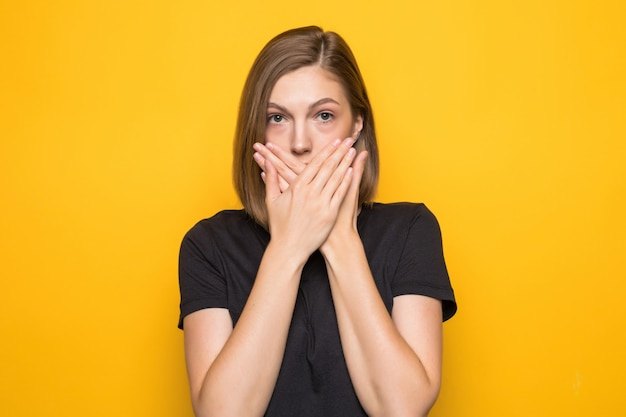 Hipster girl cover mouth with her hands. young surprised woman