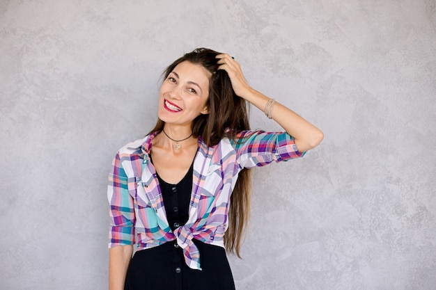 Hipster girl smile showing her teeth and playing with hair