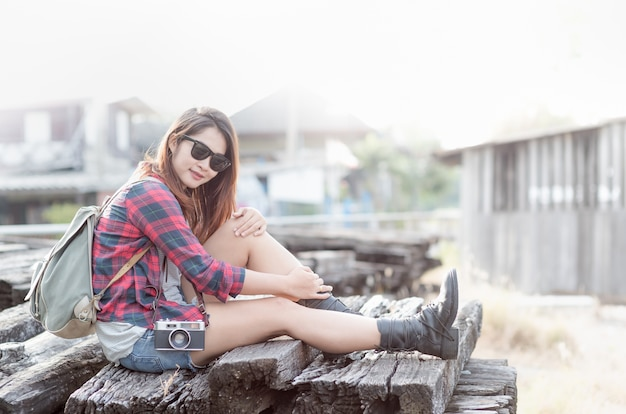 Hipster girl with bag and vintage camera