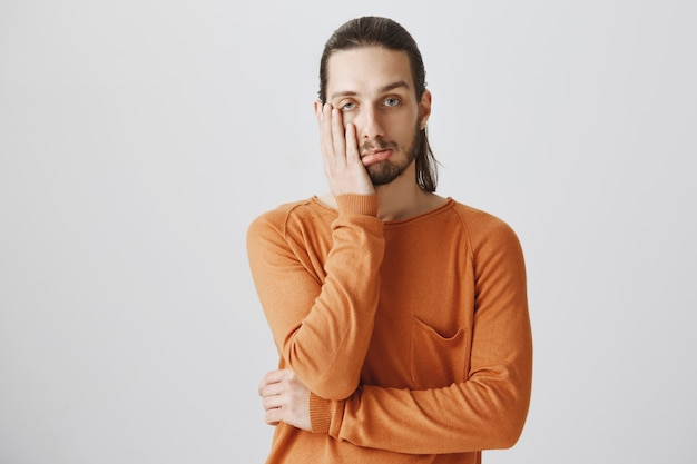Hipster guy facepalm and looking bothered