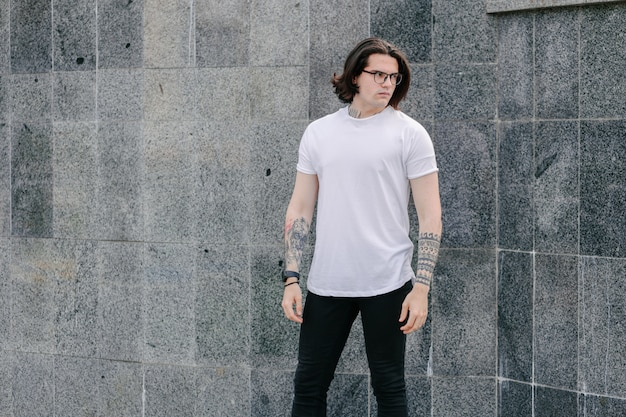Hipster handsome male model wearing white blank t-shirt