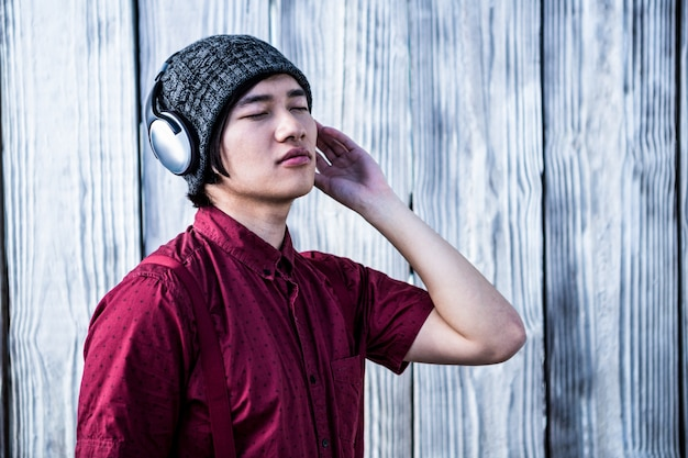 Hipster listening music with headphone