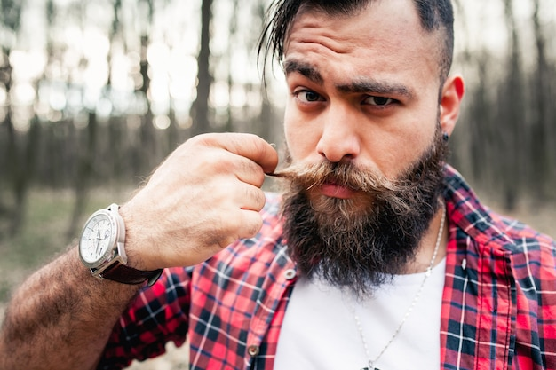 Hipster lumberjack axe chainsaw bearded beard