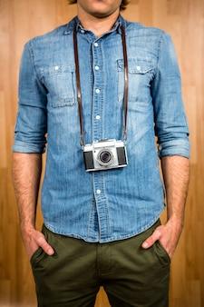 Hipster man holding digital camera