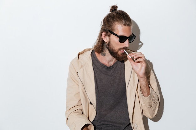 Hipster man looking aside isolated over wall