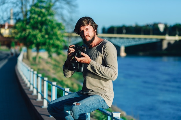 Hipster man shot photography from him film camera on street public
