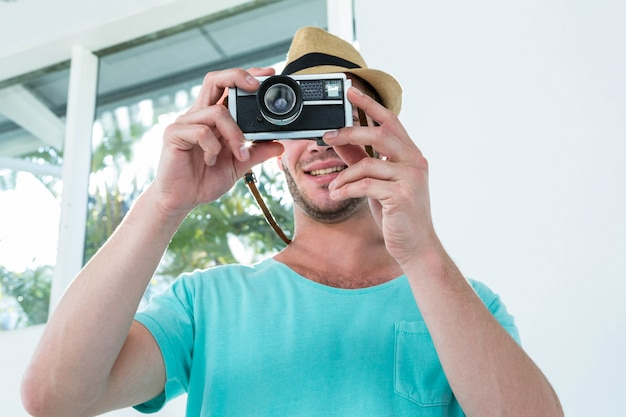 Hipster man taking picture with camera