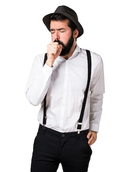 Hipster man with beard coughing a lot