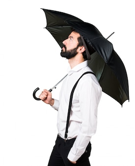 Hipster man with beard holding an umbrella