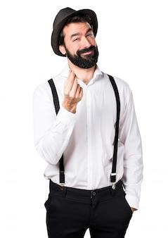 Человек-хипстер с бородой, делая денежный жест