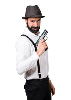 Hipster man with beard with a pistol