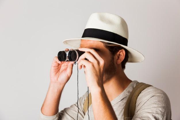 Hipster man with binoculars