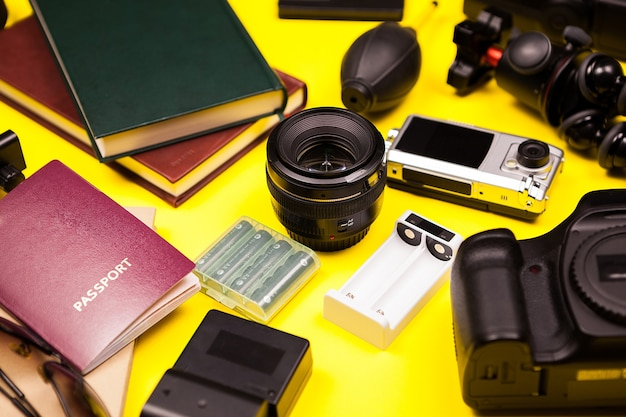 Hipster photographer blogger kit on yellow background made of dslr camera and other accessories