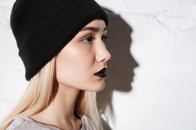 Hipster in profile over gray background