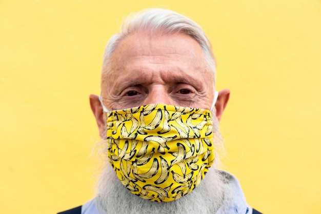 Hipster senior man wearing trendy face mask