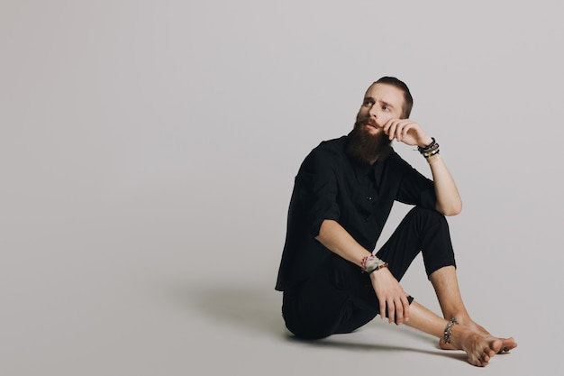 Hipster style bearded man black shirt in studio over white background