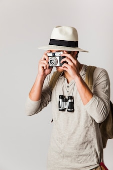 Hipster style tourist taking photo