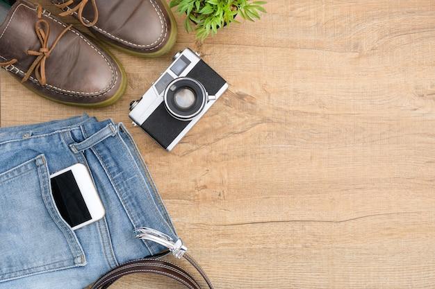 Hipster travel accessories including a retro film camera.