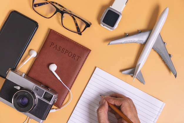 Hipster travel blogger writer accessories flatlay with hand writing