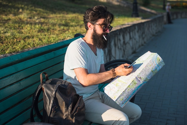 Hipster on vacation on bench
