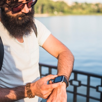 Hipster on vacation next to lake