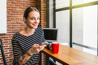 Hipster Woman freelancer using mobile and Laptop