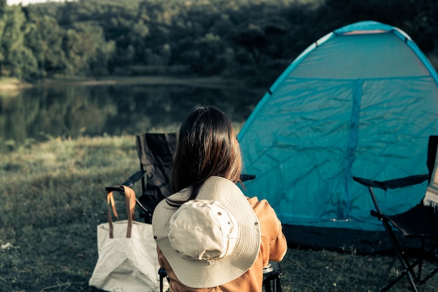 Hipster woman resting and relaxing with her camping set on the holiday and slow life.